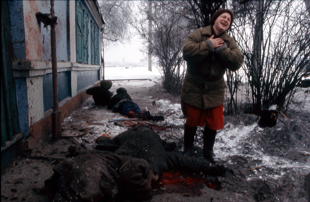 a group of civilians lay dead and dying on the streets of grozny after being hit by an artillery shell fired by advancing russian forces, chechenya 1994 © jon jones